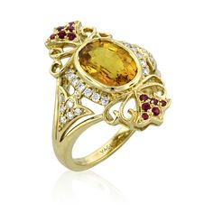 Ring in 14k yellow gold inspired by a 15th-century style with a 4.03 ct. yellow sapphire, 0.21 ct. t.w. brilliant-cut diamonds, and 0.14 ct. t.w. rubies, $11,183; Yael Designs