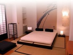 Japanese bedroom. futon bed. tatami mats. japanese lantern. japanese sliding door.