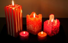 Kalevantuli candles in reddish shades. www.kalevantuli.net