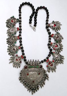 A large beautifully shaped eye catching Solid silver Banjara tribal Necklace. The center piece is dedicated to Lord Vishnu therefore its depicted with his feet's, its a custom where religious women will wear this to protect themselves as Lord Vishnu is the protector of Individual as per Hindu Bhagavad Gita(the holy Hindu book)