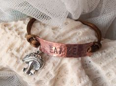 Stamped Alice in Wonderland themed copper charm by suzyandleo, $8.95
