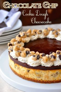 Chocolate Chip Cookie Dough Cheesecake - an ultimately indulgent cheesecake packed with chunks of cookie dough and topped with chocolate ganache and vanilla whipped cream.