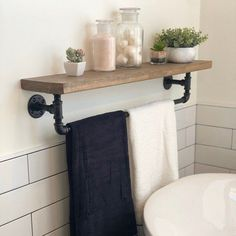 Tidy up your toiletries with this floating shelf and towel bar. The sturdy bathroom floating shelf provides storage in a rustic, yet cozy, farmhouse style. A versatile piece of industrial home décor, the handcrafted towel bar and shelf is a great addition to your bathroom, kitchen, or even commercial space. #rusticideas #rustichomedecor