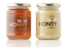 "These are pretty neat honey jars. If you look closely, the bee's stripes form the ""E"" in ""HONEY"". A very creative way of combining the text with the logo effectively."
