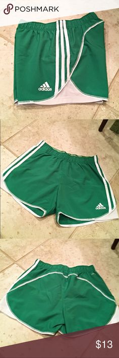 Adidas Shorts Green Adidas shorts with white detailing. 100% polyester. Great condition. 3 inch inseam. adidas Shorts