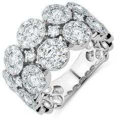 Bold and beautiful, this 2 carat total weight diamond ring in 14kt white gold is for the woman who doesn't shy away from the spotlight. Featuring round brilliant diamonds arranged in multiple clusters to dramatic effect, it is perfect for the lovers of luxe.