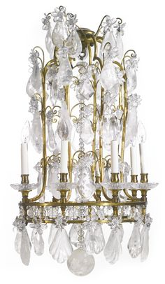 A Baroque style cut glass and rock crystal-mounted gilt bronze eight-light chandelier first half20th century | Lot | Sotheby's