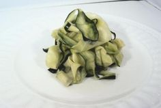 "You've Got to Try: ""Pasta"" made from strips of zucchini!   ½ cup chopped zucchini: 1.5 gram effective (net) carbohydrate plus 1 gram fiber and and 10 calories; 1 medium zucchini (about 7 oz): 5 grams effective (net) carbohydrate plus 2 grams fiber and 31 calories."