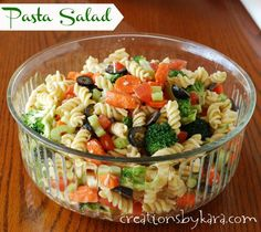 Pasta Salad: This easy pasta salad is one of my familys favorite summer meals! #pasta #salad #recipe creationsbykara.com