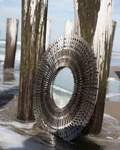 A large sunburst mirror in metal with a pewter finish. A quirky statement wall mirror for hallways, living rooms and bedrooms, in a modern/industrial style. Free delivery when you purchase this stylish mirror by Pomax.