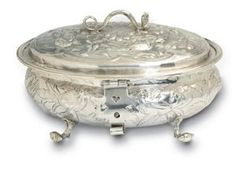 A small, silver sugar bowl from the late 1700s, complete with a tiny latch for a tiny lock. The mistress of the house would have kept the key herself, as sugar was far too precious to leave unprotected.