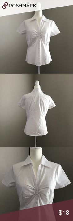 NEW YORK & COMPANY Short Sleeve Top White Size M Short Sleeve Stretch Shirt by New York & Company in white. This top is great for work or worn casual. Great for layering with a blazer or jacket. New with tags.   👗NWT 👠TTS  ✨Smoke Free/Pet Free Home  💄NO Trades   Reasonable offers are welcome! Notify me with any questions. Feel free to bundle! Thanks for shopping my closet! New York & Company Tops Button Down Shirts