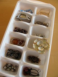 An ice cube tray used for jewelry storage