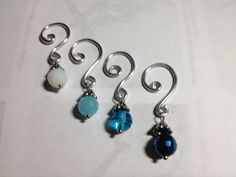 Shades of blue crochet or knit stitch markers.