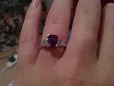 My engagement ring! Amethyst is my favourite, and apparently you cant get an Amethyst ring in platinum anywhere, its ridiculous! So he got it made, all by himself!