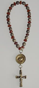 Rosary with a Pendant in the Form of the Head of St John the Baptist and with a Cross   Amber, silver and cotton; carved, engraved, gilded and filigreed. L. 14 cm, diam. of icon 2.7 cm, l. of cross 4.5 cm   Western Europe. 16th century