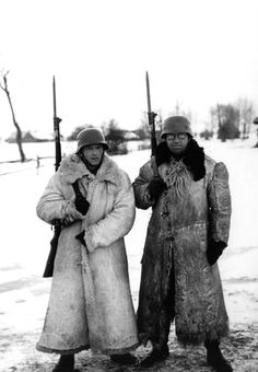 Two German soldiers on the Eastern Front don local fur coats in the absence of standard issue polar clothing for the German army. Undated. During the first Russian winter of the German campaign, thousands of German soldiers were incapacitated or died because of lack of proper winter clothing.