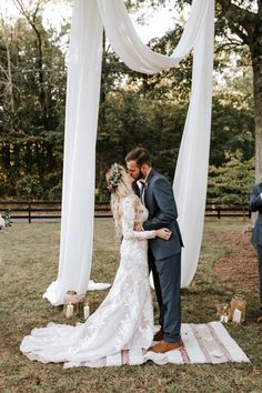 draped fabric and boho rug at the ceremony altar