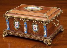 <b>A fine Louis XVI style kingwood and ormolu mounted table casket</b> <br  /> French, circa 1890, with serpentine two-piece opening front and hinged lid, revealing an ivory silk interior, applied throughout with gilt metal mounts and Sevres style porcelain plaques and pillars, twin foliate side handles and pierced swagged foliate scroll feet, engraved lock plates and hinges, 18 x 13 1/4in. (45.5 x 33.5cm.), 9 1/4in. (23.5cm.) high. <br  />