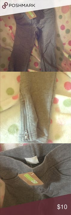 Girls grey leggings Brand new with tags, zippers on the bottoms, grey leggings! 💕💜💕 crazy 8 Bottoms Leggings