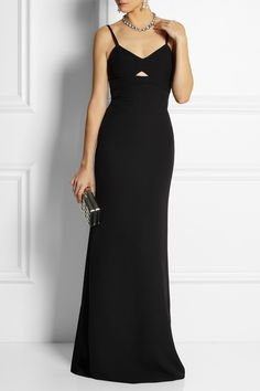 VICTORIA BECKHAM Cutout silk and wool-blend gown $3,795 The perfect mix of classic and contemporary, Victoria Beckham's black floor-length gown features a cutout bodice and an elegant puddle train. This paneled silk and wool-blend piece is finished with a figure-flattering trim underneath the bust and an exposed zip through the back.  Shown here with: Kenneth Jay Lane earrings, Rochas necklace, Gianvito Rossi shoes, Fendi clutch.