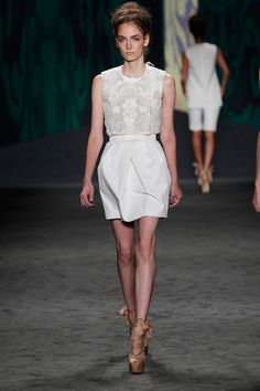 White cotton canvas cropped sleeveless choli jacket with soutache embroidery over white cotton canvas sleeveless corseted dress with tulip skirt   Photography: Dan Lecca