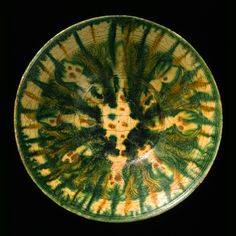 Earthenware bowl, covered by a white slip with incised ornamentation and decorated with splashes of color in a transparent glaze  Eastern Iran or Central Asia; 10th century  H: 7.5; Diam: 25.5 cm