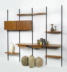 The 'Sistema E22' modular shelving system designed by Osvaldo Borsani in the 1950's with a few nice ceramic pieces, including works by Lea Halpern. Photo: Sothebys #mcmdaily #osvaldoborsani #leahalpern #italy mcmdaily.com
