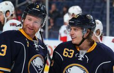 Jordan Leopold #3 and Tyler Ennis #63 of the Buffalo Sabres  (Photo by Bill Wippert/NHLI via Getty Images)