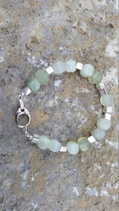 Jade and sterling. https://www.etsy.com/listing/232610873/jade-sterling-silver-chic-boho-artisan