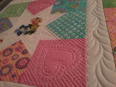 Hi-De-Ho quilt, using Hi-De-Ho fabric from Moda.  Being quilted, feathered hearts in the corners.