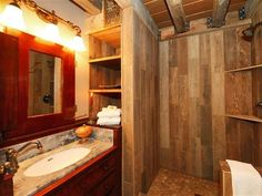 Sundance cabin rental - rustic bathroom with wood tiled shower and antique dry sink