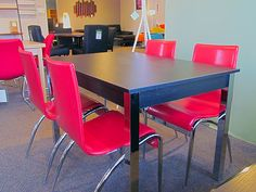 Zoom dining table in black wood and chrome legs. Was $499 Now $299