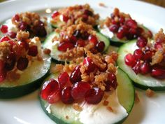Cucumber, Pomegranate and Bacon Canape    Thinly sliced Cucumber  Thin spread of low fat Philadelphia Cream Cheese  Cover with Pomegranate seeds  Sprinkle with bacon bits  Serve chilled.