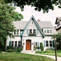 Looks like gingerbread house. Cottage style with window boxes and curved front door. Candy Lane Home. When in doubt, blue is always the perfectly complementary color! Cute House, House 2, Dream House Exterior, House Exteriors, Cottage Exterior, Cottage Homes, Tudor Cottage, Cottage Style, House Goals