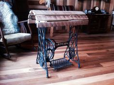 Saddle stand - incorporating the base of an old Singer treadle sewing machine