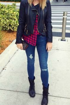Casual everyday fall outfit idea with ripped jeans combat boots and a flannel button down shirt with a motorcycle jacket. Perfect for school or a day at the mall