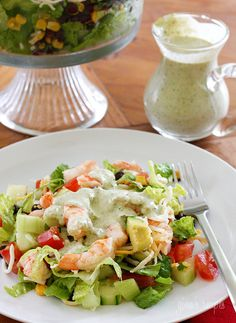 Mexican Shrimp Cobb Salad - a beautifully layered salad with shrimp, avocados, grilled corn, black bean salsa, cucumbers, tomatoes and cheese.