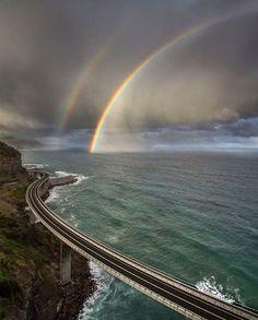 Sea Cliff Bridge with Rainbow by David Wimble on .Sea Cliff Bridge in South Coast, Sea Cliff Bridge, Beautiful World, Beautiful Places, Wonderful Places, Beautiful Scenery, Stunning View, Amazing Things, Amazing Places, Jolie Photo