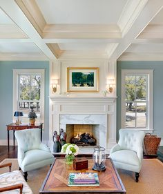 Love the paneling on fireplace and mantel--tied to coffered ceiling.