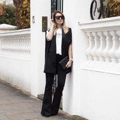 Black flared trousers, HM x BALMAIN tee and Blazer, Mango Boots, Maniere De Voir sunglasses and a Saint Laurent WOC