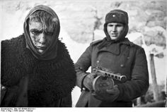 Russian soldier with PPSh-41 submachine gun guarding a wounded young German prisoner of war, Stalingrad, Russia, Jan 1943 | World War II Database