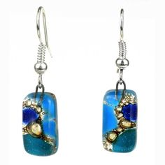 These one-of-a-kind earrings are created by Chilean artisans using skills that have been passed down for generations. The fused glass earrings feature multiple shades of blue and unique bubble accents