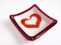 This ring dish makes a great home decor piece, anniversary gift, bridal shower favor / gift, or wedding gift / party favor. This fused glass art jewelry dish is great for holding a wedding ring or other small items. It is all glass, even the heart . It is NOT painted. The image will NOT peel. This dish can also be customized with a monogram instead of the heart. I can also fulfill large order amounts as wedding party favors. Just convo me.  Decorate your home or give as a gift . Dim...