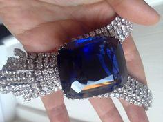 Blue Belle of Asia 392ct sapphire in hand (Vanessa Cron/Christie's)
