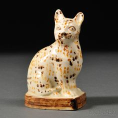 Staffordshire Cream-colored Earthenware Model of a Speckled Cat