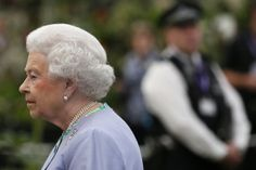 Queen Elizabeth II looks at a dispaly during a visit to the Chelsea Flower Show on press day on May 19, 2014 in London, England.