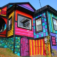 Variety: This building shows variety by using different patterns and colors to create a design. When the bright colors and black trim mix, it creates uniqueness.