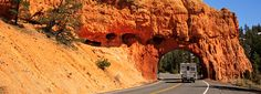 Rock arch in a red rock formation, road tunnel, Red Canyon, Utah, United States