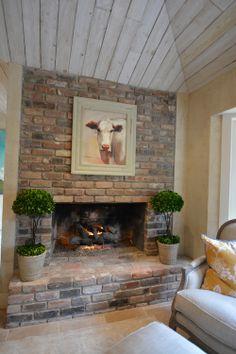 original fireplace. cow painting.